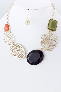 $58 Gorgeous golden delicate Lotus mixed with organic Laser cut shapes and bold Faceted Cut resin stones.