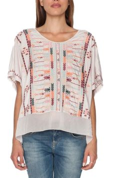 The Vana Georgette Poncho Tee is adorned by a detailed Moroccan-inspired embroidery design along both the front and back, accented by a georgette ruffle hem. Cut for a relaxed, draped fit, the Vana pairs perfectly with shorts or linen pants now, and your favorite pair of jeans in colder months! Machine wash cold and tumble dry low.  The Vana Poncho by Johnny Was. Clothing - Tops - Short Sleeve Clothing - Tops - Tees & Tanks Laredo, Texas