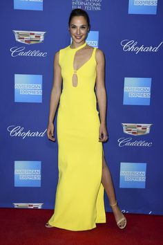 Gal Gadot wears a yellow dress and strappy nude sandals at the Palm Springs International Film Festival in January 2018. #galgadot #redcarpet #wonderwoman #celebrity Gal Gadot, International Film Festival, Red Carpet Looks, Red Carpet Fashion, Yellow Dress, Wearing Black, Star Fashion, Style Icons, January 2018