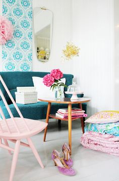 I love everything, the table, shoes, quilts, pink chair, the mirror and the blue and white paper on the walls.