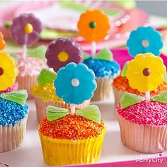 Grow a colorful cupcake garden on the dessert table with flower lollipops and sprinkles!