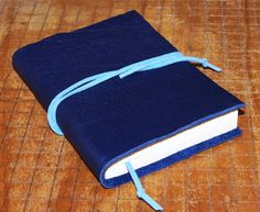alternative to River Song's diary: BLUE Pocket Leather Journal LINED paper Small Diary Jotter Leather Gift for Writer. $19.00, via Etsy.