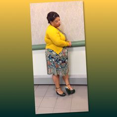 I just love this multi color below the knee length flowy dress and adorable mustard yellow cardigan! And then her wedged heels match perfectly;) This whole ensemble is great for meeting and field service