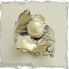 Engagement ring - Sterling silver leaf ring with a fresh water pearl - Swirling leaves. $76.00, via Etsy.