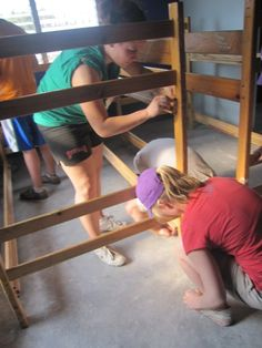 Holy Cross Building Brigade 2010:    Setting up beds in the new boys house