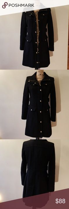 Guess Coat Excellent condition Absolutely flattering and beautiful   Black coat with gold buttons a s zipper . Zipper can be hidden when buttoned up. 2 pockets on the outside   Has a built in belt which is very flattering to the stomach  Very cozy.. keeps you warm!  Check picture for coat material Guess Jackets & Coats