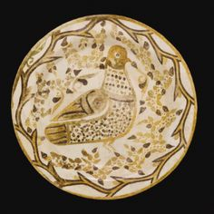 A Rare Abbasid Bichrome Lustre Plate with a bird in foliage, Iraq, 9th century - Sotheby's