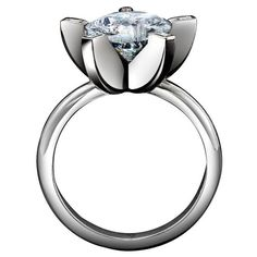 """A unique design, this """"claw"""" ring from Solange, 212-879-9100, holds a round-cut diamond in the center of a platinum setting."""