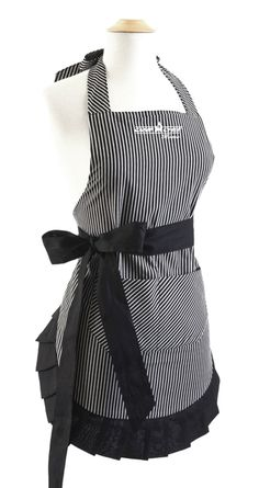 Introducing our new, limited edition women's apron exclusively from our Camp Chef Home collection; just in time for the holidays. It features a white pinstripe on a black background with an adorable ruffle hem, waist pocket, and adjustable ties at the neck and waist. A perfect gift for a loved one, or yourself! Find it here: http://www.campchef.com/womens-apron.html | #CampChef #Apron #Cooking
