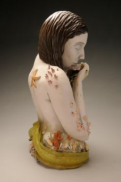 Sea Goddess Figure, painted ceramic bust.  Use of extra ceramic material to create shapes to represent parts of identity and to make up who you are as a person. This is also expressed through the use of colour and decorative carving and line work. This creates a real life texture. There is a contrast between smooth and detailed textures