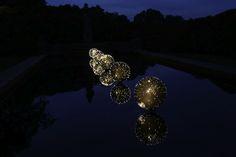 Illuminated Floating Orbs Create a Dazzling Garden Display - My Modern Metropolis