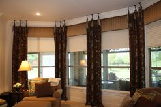 Basket weave silk cornice boards paired with ceiling mount drapery with silk sashes.