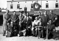 Lodz, Poland, Ghetto supply depot workers. Sitting in the center is Szczesliwy. Beside him (in white) is Rajngold.