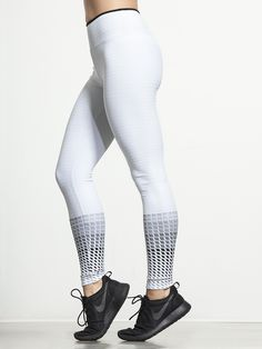 Supportive, sexy and stylish, the Gradient Legging from Koral is simply stunning. We're in love with the grid-style fabric that keeps everything compressed to give you the best in performance, and the high-rise foldover waistband makes sure you stay comfortable when you kick it into high gear.