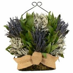 "Showcasing an array of preserved lavender and sage nestled in a charming basket, this beautiful arrangement brings Provencal-inspired elegance to your decor.    Product: CenterpieceConstruction Material: Burlap, wire, twig and preserved leaves, moss and lavenderColor: Multi Dimensions: 15"" DiameterCleaning and Care: Avoid sunlight, moisture,  heat and humidity. Wipe clean with a dry cloth"