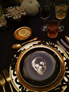 luxe dark table setting tablescape black and gold skull
