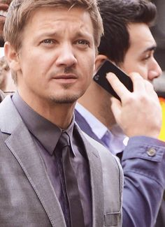 Jeremy Renner in the process of ruining lives and breaking hearts while celebrating Scarlett Johansson's star on the Hollywood Walk Of Fame.