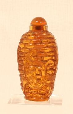 Vintage Chinese amber colored snuff bottle