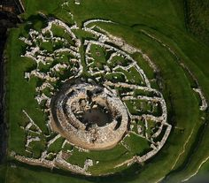 Aerial View: 'The Broch o' Gurness' (Iron Age broch village on the northwest coast of Mainland Orkney in Scotland overlooking Eynhallow Sound.)