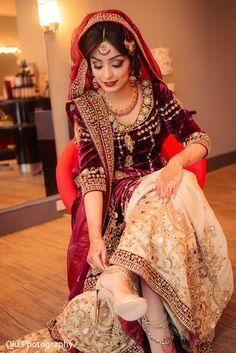 Indian bride wearing bridal lehenga and jewellery
