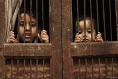 """The children pressed against the barred window,  watching silently as the slave traders took there parents away.  """"Mommy"""" one of them whispered, unable to comprehend what was going on."""