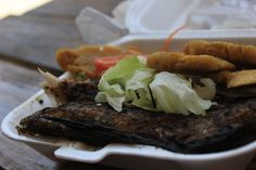 Fried Snapper fish with dumplings and salad ( Haiti )