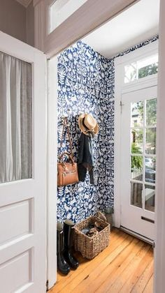 A bright entryway featuring Otomi wallpaper from Hygge & West