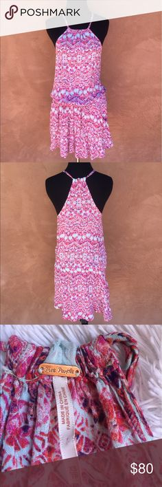 """Free People patterned cinched dress Free People dress. Cinched waistline (can be worn higher or lower on hips/waist). Halter top straps on back/front. Adorable and such a find with two POCKETS!!! on either side of the dress right under cinching! Adorable pink, light blue, red and hint of purple colored patterning throughout dress. Length approx 34"""", bust approx 32"""". Scooped out sides. Please feel free to ask any questions or submit offers if you're interested:) Free People Dresses Mini"""