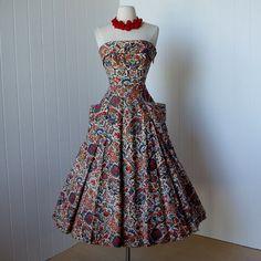 http://www.etsy.com/listing/73485290/vintage-1940s-dress-phenomenal-rare
