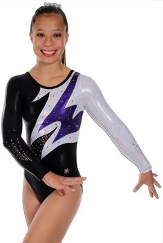 Flare Version B Gymnastics Competition Leotard~ This Flare gymnastics competition leotard is shown in three versions and three price points. The body of these leotards are all made from our shiny black mystique nylon lycra. Each version has different colored accents to make this gymnastics leotard pop on the floor. These competition leotards are adorned with genuine Swarovski crystals to make it really stand out. Version B Body - Black mystique and silver hologram, Accents - Purple Sparkle.