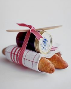 JAM GIFT PACKAGE .... This small, THOUGHTFUL GIFT is a good way to THANK any one OR for any other occasion too... Wrap two loaves of your favorite crusty bread (we like French baguettes) in a linen dish towel, and top with a jar of YOUR homemade , ( or STORE BOUGHT ) jam. Tie them together with a colourful ribbon to match the towel, securing a wooden spreader in the knot of the bow. Nice for CHRISTMAS or a TEACHERS Gift too !