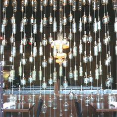 Glass bottle wall at Jefe restaurant