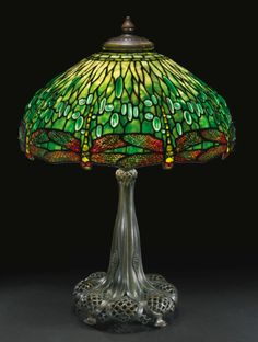 "Tiffany Studios ""HANGING HEAD DRAGONFLY"" TABLE LAMP with a telescopic base shade impressed TIFFANY STUDIOS/NEW YORK/1507 base impressed TIFFANY STUDIOS/NEW YORK/397 (partially obscured) leaded glass and patinated bronze 29 3/8  in. (74.6 cm) high as shown 22 3/4  in. (57.7 cm) diameter of shade circa 1910"