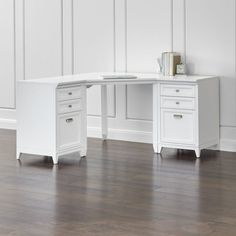 Classically handsome and eminently versatile, our Harrison modular furniture collection conquers home office clutter in style. Each modular piece is crafted of hardwood and hardwood veneer with a warm white finish, with brushed stainless drawer pulls. Designed by Blake Tovin of Tovin DesignHardwood, engineered wood and hardwood veneerBrushed stainless hardwareDesktop can support up to 200 lbs.