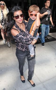 Kourtney Kardashian wearing Balenciaga Button Ballet Flat Bleulab Angle Legging in Nitre Wash Balenciaga Black Arena Classic Square Bag Siwy Shirt Cartier Love Bracelet  Leaving her hotel in New York September 2 2011