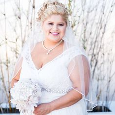 This sleeveless plus size wedding gown has an empire waist line.  Custom #plussizeweddingdresses can be made at a great price by our firm.  We also make #replicas of couture #dresses too for brides who can not afford the original but want the same or similar look.  For more info on custom #weddingdresses and inspired designs email us directly.  DariusCordell.com