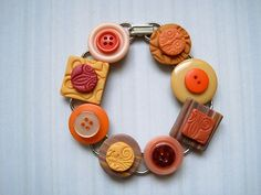 Repurposed Vintage Button Bracelet with Clay Tiles in Tangerine and Peach.  Such a fun piece!