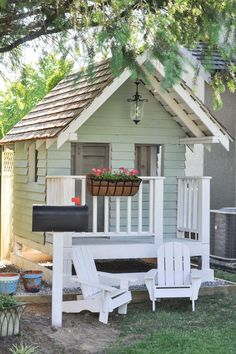 DIY Outdoor Playhouse idea for kids, including accessories like flowers, lights, furniture and more!