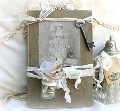 Vintage Embellished Book - 16.50 -   This is a vintage book from the late 1800's ~  It has been embellished with an old bottle, a vintage skeleton key, vintage buttons, and a vintage photo printed on fabric ~  http://www.katiesrosecottagedesigns.com