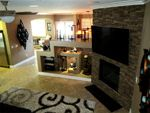 Dry stacked stone brings a natural element to this living room and entertainment center.   Fireplace?