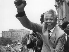 Mandela holding his fist in the air