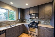 Contemporary kitchen remodel with sleek cabinets and a tile backsplash in shades of gray. Discovered on www.Porch.com Kitchen Cabinet Colors, Kitchen Colors, Kitchen Cabinets, Backsplash, Kitchen Remodel, Porch, Tile, Shades, Colorful
