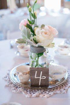 Table top number and mason jar centerpiece. http://www.abodevenue.com
