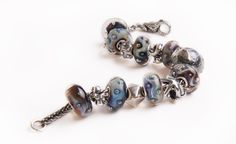 Bracelet with Azure Bubbles #trollbeads #bloomingboutique #shopsmall http://www.bloomingboutiquebeads.com/home.html