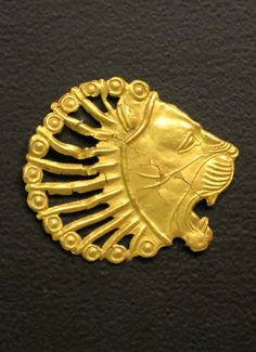 Golden Achaemenid ornament depicting a lion's head and dating back to the 5th-6th century BCE. The city of Babylon served as the main imperial capital for the Achaemenid Persians until 331 BCE.