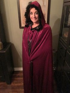 A personal favorite from my Etsy shop https://www.etsy.com/listing/289956029/witch-cape-red-velvet-feathers-trim