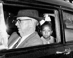 Ruby Bridges one of the first African American children to attend an all white school in the American south. She was escorted by the Feds for her safety.