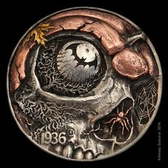 Halloween is an awesome source of inspiration for hobo nickel artists. This spooktacular hobo nickel, entitled Nightmares of the Fall, was engraved on a 1936 Full Horn Buffalo Nickel by Russian-born, New Jersey-based engraver-designer Aleksey Saburov. All of the engraving was done by hand and the piece was finished with 24-karat gold, silver and copper inlay.