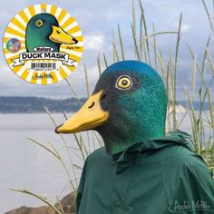 This Mallard Duck Mask is beautifully detailed and we added a reflective layer that gives the green feathers a pearlescent sheen. In fact, it's so realistic you may find yourself tramping through puddles and getting hungry for damp bread.