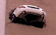 Driver reverses car through wall on seventh story of parking garage